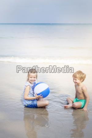 girl and boy playing water ball