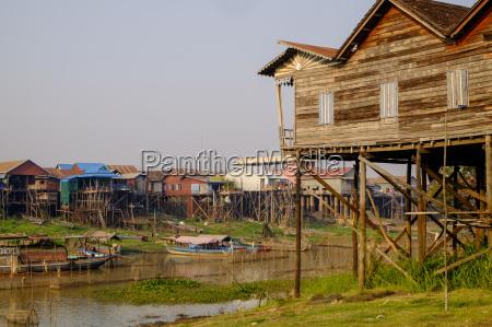 stilt houses in village along the