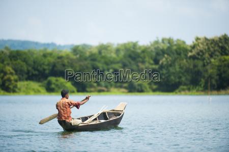 a fisherman on kaptai lake in