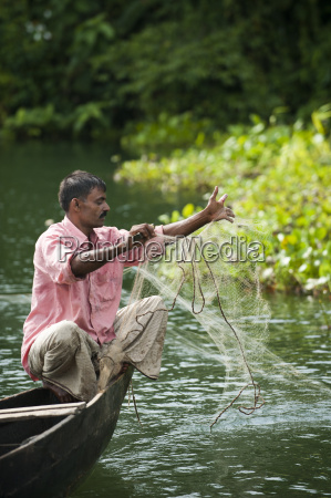 a man pulls in his fishing