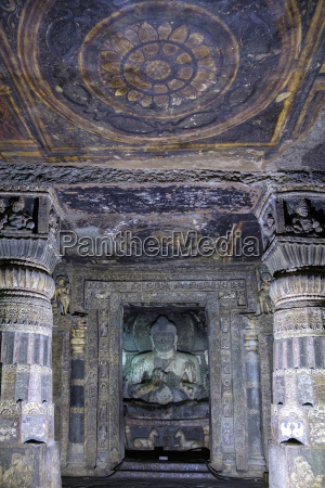 buddha statue and painting in the