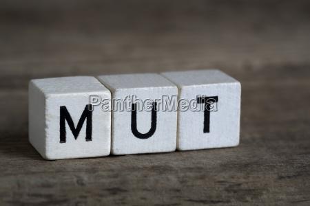 german word courage written in cubes