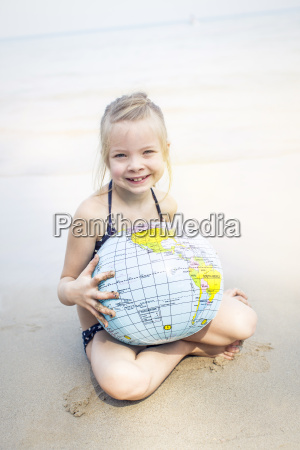 little girl with water ball at