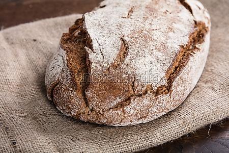fresh baked bread on sack