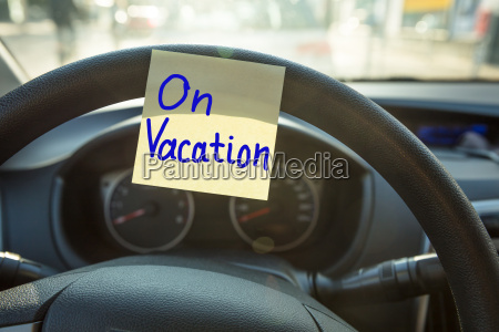 vacation concept on steering wheel