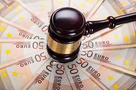 the gavel strike on banknote