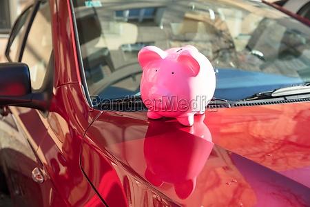 piggybank on car