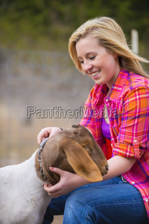 usa texas teenage girl petting boer