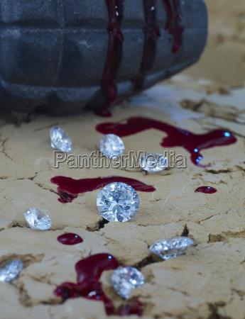 diamanten und blut auf erde mit