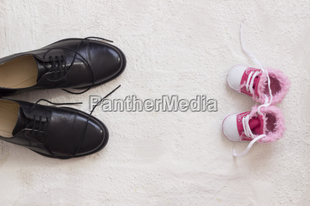 baby shoes and mans shoes