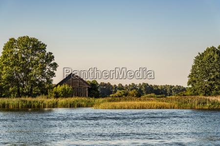 poland masuria barn at lake sniardwy