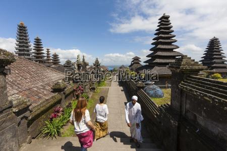 indonesia people walking at pura penataran