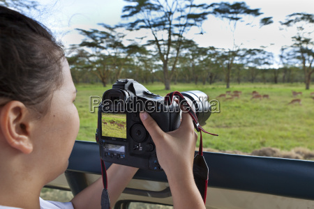 africa kenya teenage girl taking picture