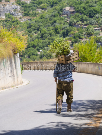 italy sicily modica old man carrying