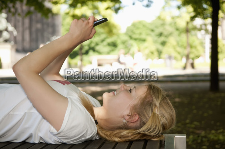 germany berlin young woman lying on