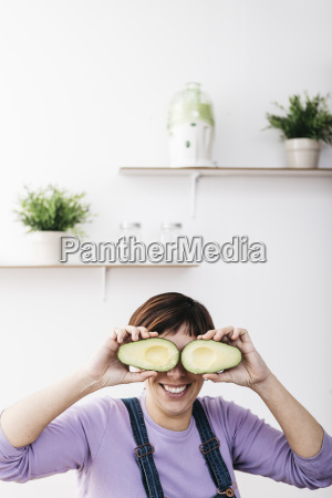 smiling woman covering her eyes with