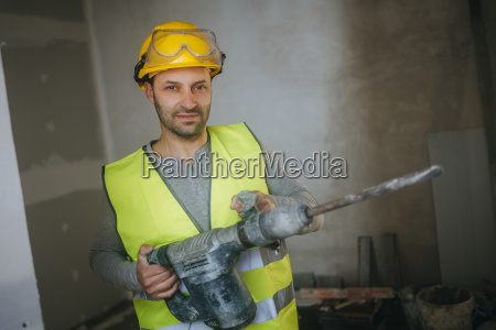 portrait of construction worker holding a