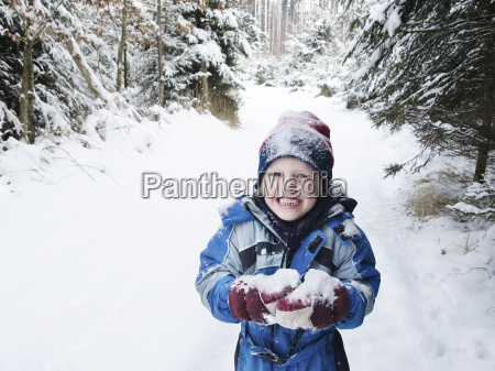 austria boy playing with snow in