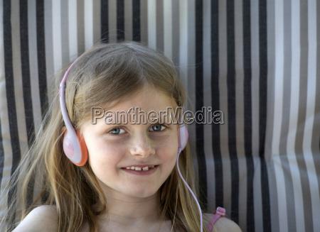 austria girl with headphones sitting on