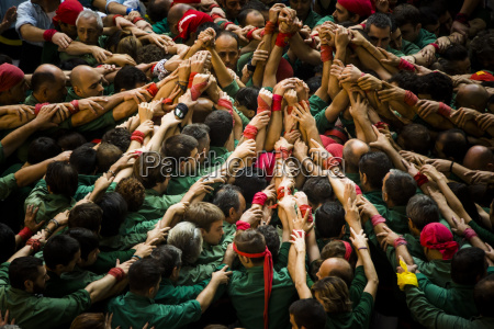 spain catalonia people buildling human tower