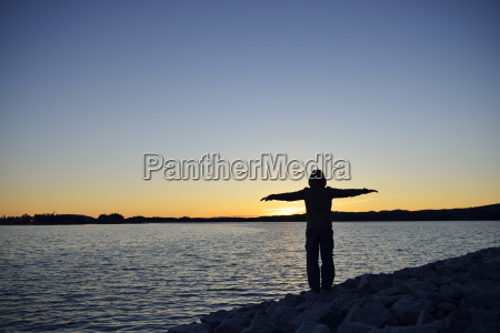 sweden storuman man standing at lake