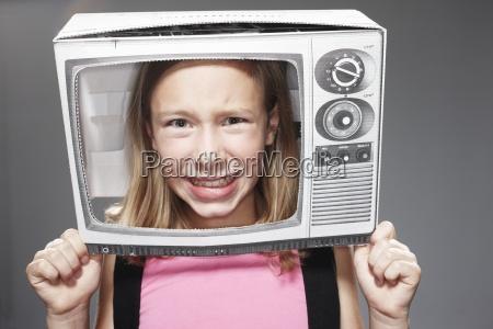 girl anxious in paper tv against