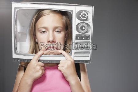 sad girl in paper tv against