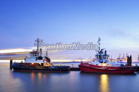 germany hamburg harbor with tugboats at