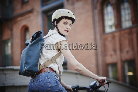 portrait of young woman with cycling