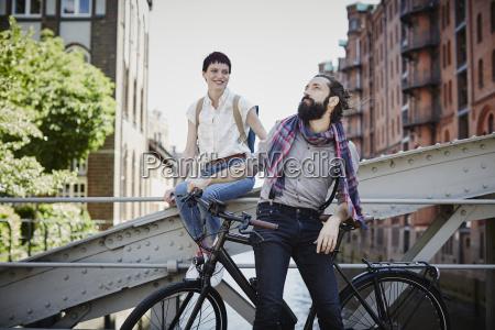 germany hamburg couple with electric bicycle