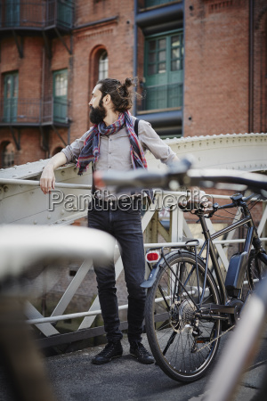 germany hamburg hipster with electric bicycle