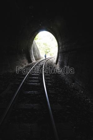 bulgaria young boy walking in railroad