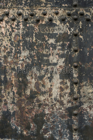 colour flaking from old metal wall