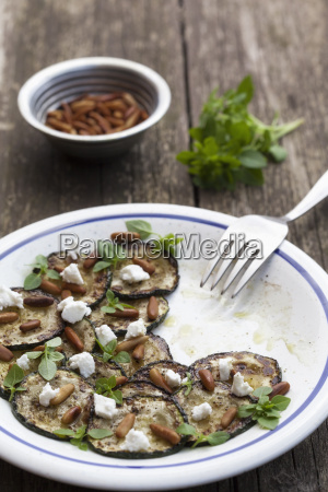 plate of feta salad with nuts