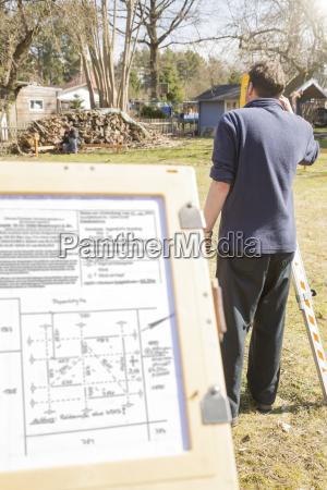 germany brandenburg men surveying at construction