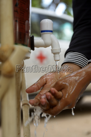 cambodia takeo province woman washing hands