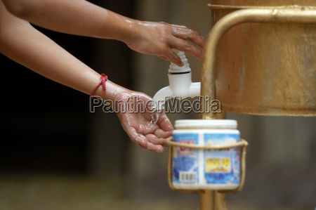 cambodia takeo province boy washing hands