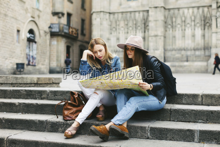 spain barcelona two young women reading