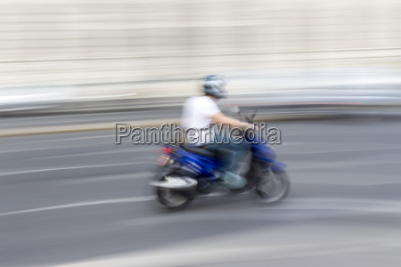austria vienna scooterist driving on a