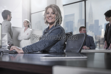smiling woman at desk in city