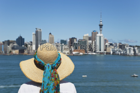 new zealand woman looking at auckland