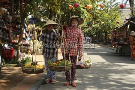 vietnam hoi an two fruit carriers