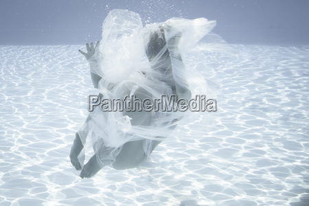young woman wrapped in cloth floating