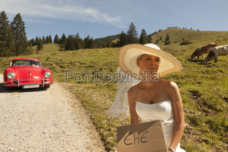 bride waiting wayside of a pasture