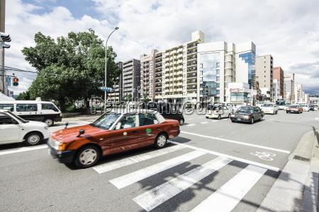 japan kyoto cars on street houses