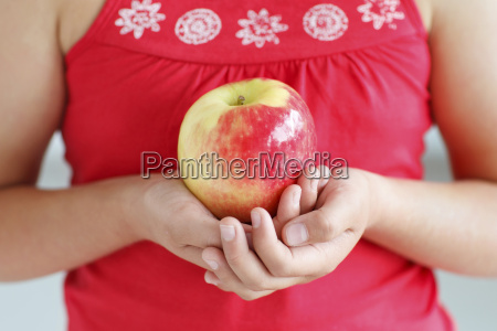 girl holding an apple close up
