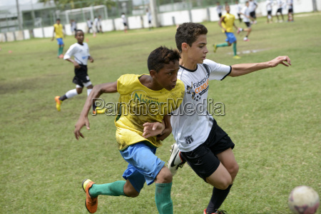 brazil fortaleza street children playing soccer