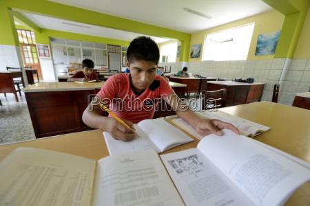 peru brena pupils doing homework in