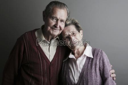 portrait of senior couple smiling close