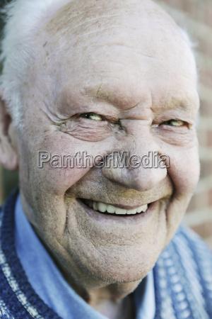 germany portrait of senior man smiling